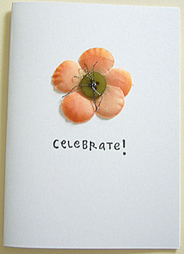 celebrate this day. a happy birthday card handmade with button and silk flower.