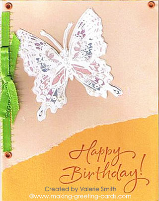 Sending Happy Birthday wishes with butterfly and ribbon.