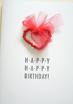 Happy Happy Birthday! A handmade birthday card with beads and ribbon.