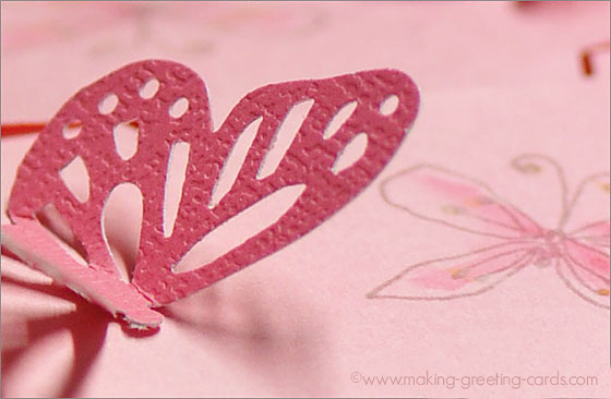 Pink Die-cut Butterfly on Watercolor Paper with Stamped Dragonfly